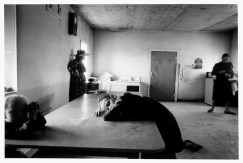 MEXICO. Zacatecas. La Batea. 1992. Child rests her head on the kitchen table. Many Mennonite families have left Mexico in search of seasonal employment in North America.