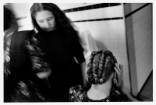 CANADA. Ontario. Lambton County. 1992. The Reddekop girls preparing their hair on Saturday afternoon. Old Colony Mennonite girls and women braid their hair on Saturday. The family is originally from the La Batea Colony, Zacatecas, Mexico.