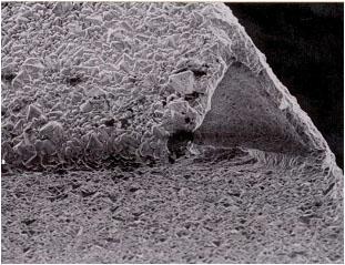 Diamond delamination (large grain size).