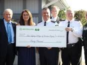Metrolinx, the province's transit authority, renewed its commitment to the Durham Kids' Safety Village, donating $30,000 toward upkeep and maintenance of the facility. On hand for the cheque presentation were Dave Ryan, Kids' Safety Village board member; DRPS Staff Sgt. Darren Nesbitt; Lennis Trotter, chairman of the board for the Kids' Safety Village; Sandra McDowell, publisher of The Oshawa Express and with the Kids' Safety Village; Peter Tietze, Kids' Safety Village board member; Bill Grodzinski, director of safety and security for Metrolinx; Steve Harvey, manager of operational support for safety and security for Metrolinx; Const. Astrid Morse, the constable in charge of the Kids' Safety Village; and Peter Mohyla, a community safety officer with GO Transit.