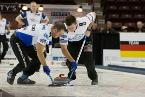 Derek Samagalski, left, and Braeden Moskowy eye down a rock in the Grand Slam of Curling final on Nov. 15 at the General Motors Center. Their team, skipped by Winnipeg's Reid Carruthers, would fall in the finals against the team headed by Brad Gushue