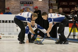 Brad Gushe (centre) releases a rock as his teammates Geoff Walker (left) and Brett Gallant sweep. Despite a headfirst fall onto the ice last month that required seven stiches above his right eye, Gushue rebounded to win the Grand Slam of Curling in Oshawa on Nov. 15.