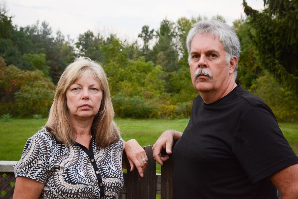 Halina Workman and Justin Kennedy are among a number of Tooley Road residents calling on the provincial and municipal governments to slow down on development of the area, saying the green space that has been there for decades will soon be gone.