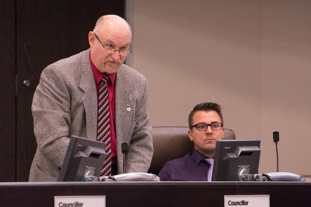 Councillor Doug Sanders speaks in council chambers, while Councillor John Shields looks on, when the first draft of the 2017 city budget was introduced. This first draft comes with a tax increase of 2.5 per cent.