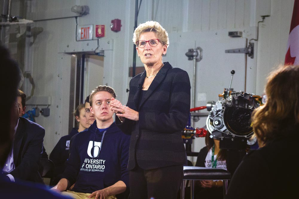 Premier Kathleen Wynne was at Durham College and UOIT Monday as part of a provincial tour that sees her holding roundtable discussions with residents. Colleges Ontario, meanwhile, is calling for a meeting with Wynne to discuss what it sees as an impending financial crisis.