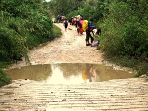 with portions of the road flooded, transports were hesitant to come through and pick us up. people began walking towards the main road: the great hippie exodus.