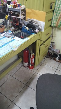 Extinguisher located in office under desk. Source: Image captured from mobile device