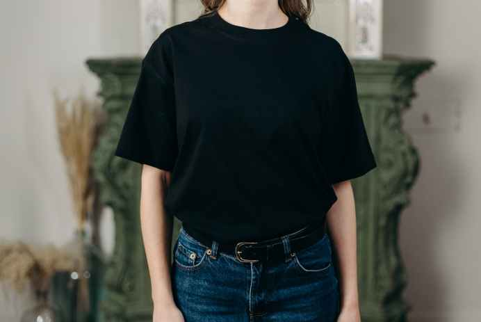 person in black crew neck t shirt and blue denim jeans
