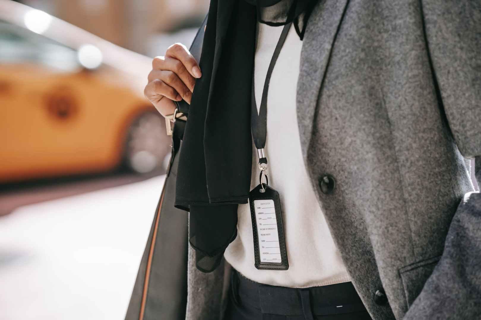 anonymous stylish businesswoman walking on city street