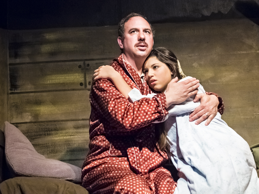 """OTTO FRANK (John Palacio) attempts to comfort a distraught Anne (Nava Schorsch) from her nightmares in the Riverdale Y performance of  """"The Diary of Anne Frank""""."""