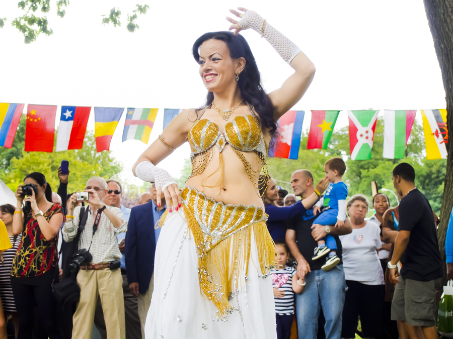 NOORA ESHAMS belly dances for the audience at International Family Day along Goulden and Mosholu Parkway on Sunday.