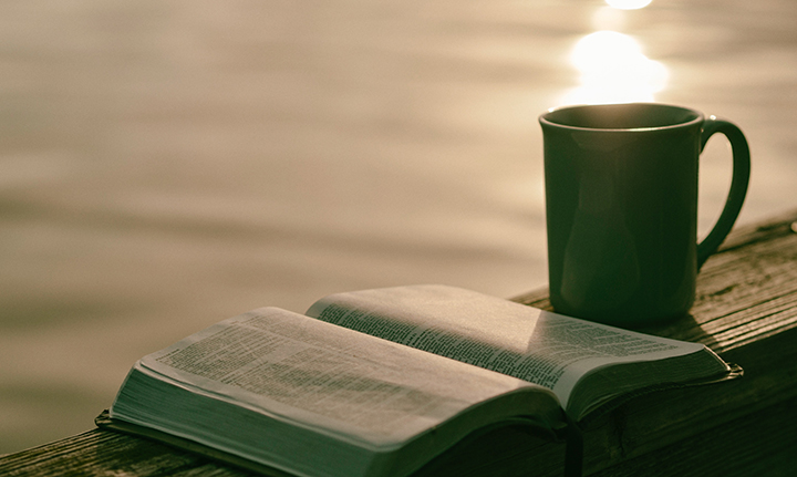 Photo of Bible and coffee cup