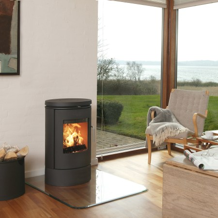 Morso 6140 wood burning stove on glass plinth on wooden floor