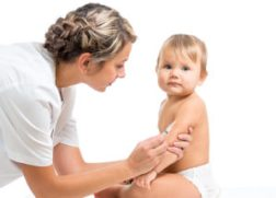 Pediatrics doctor giving baby child vaccine injection