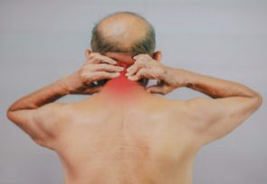 senior man massaging chronic pain area