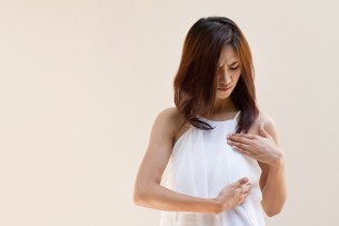 Breast Cancer woman examines her breast