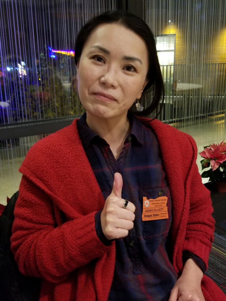 2018 Master Gardener gives thumbs up as she proudly wears her OSU Master Gardener badge