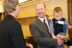 Young Alumni Award recipient Nathan Snyder with his son.