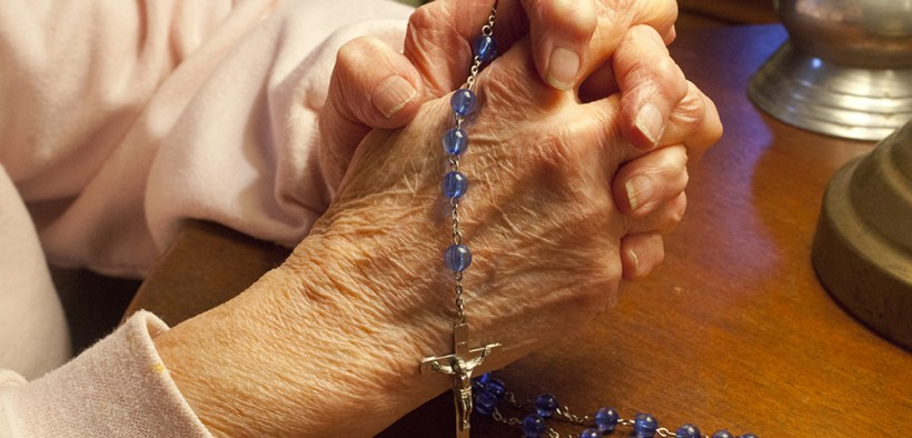 Elderly woman praying