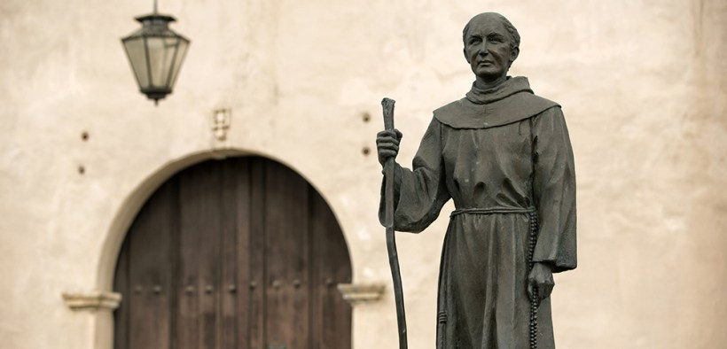 Statue of Blessed Junipero Serra stands outside San Gabriel Mission in California