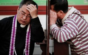 PRIEST CONFESSION CHINA CATHEDRAL