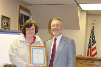 Supervisor Stephen J. Stelmashuck presents Elizabeth Dunham with a certificate of appreciation from the Town of Parish for her assistance and many services for the Town of Parish Justice System .