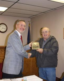 Supervisor Stephen J. Stelmashuck presents Bob Frederick with a plaque recognizing his years of service on the Town of Parish Board of Appeals and Town Council. 2004-2009