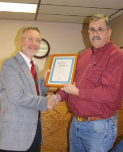 Supervisor Stephen J. Stelmashuck presents John Dunham with a certificate of appreciation from the Town of Parish for filling in as Codes Enforcement Officer for the Town of Parish while there is a vacancy.