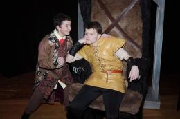 Angered because he was rejected by the girl he wants to claim for his own, Gaston (Alex Bawarski - right) sits and sulks as his comic sidekick Lefou (played by Nathan Deavers - left) tries to cheer him up. Photo by Dave Dayger.