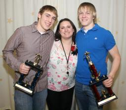 The team's two departing seniors earned the Speed Demons' two highest honors. At left, Josh Strauss holds the Teammate Award, which is voted on by all of the team's members. At right, Scott Bullard holds the Coaches' Award, given by the team's coaches. They are with longtime assistant coach and first year Head Coach Cassandra Izyk.