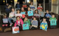 Some of the children show off their artworks