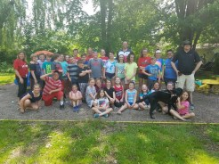 Students in grade third through sixth serving as members of Lanigan's Student Congress each picked a friend to help clean Patrick Park along with Principal Jeff Hendrickson, AmeriCorps member Tim Conners, and Third Ward City Councilor Don Patrick Jr.
