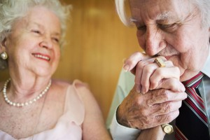 elderly-man-kissing-wifes-hand-2_large