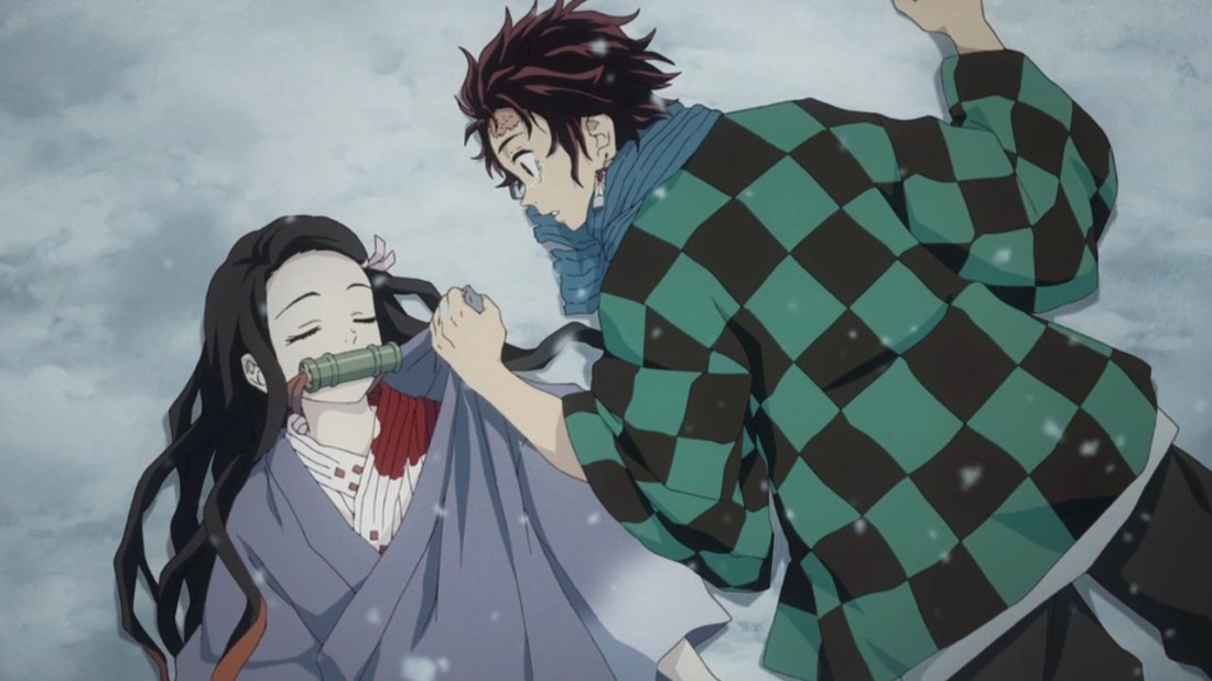 Nezuko (muzzled) and Tanjiro