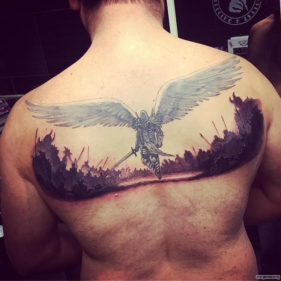 архангел и воины тату на спине у парня добавлено иван вишневский