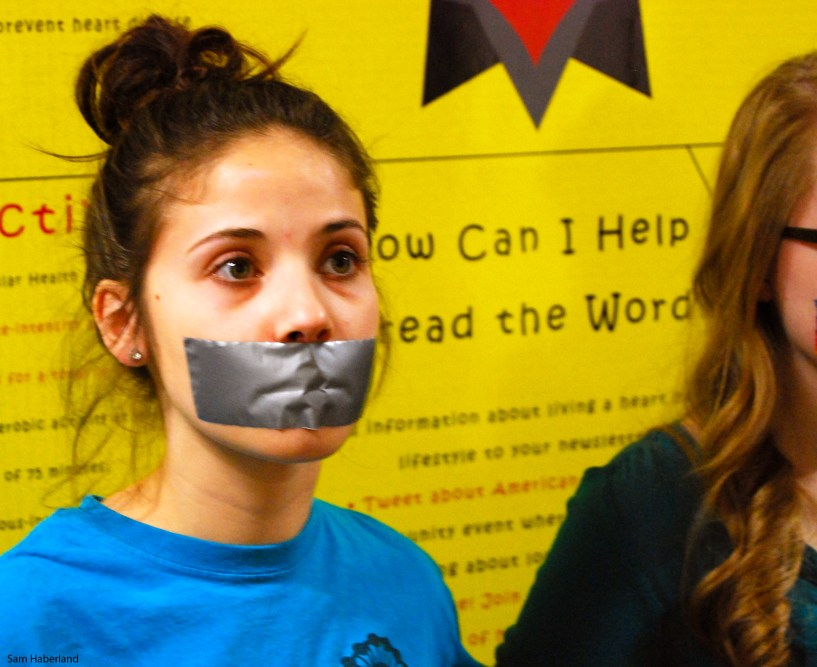 Girl with Mouth Taped Shut