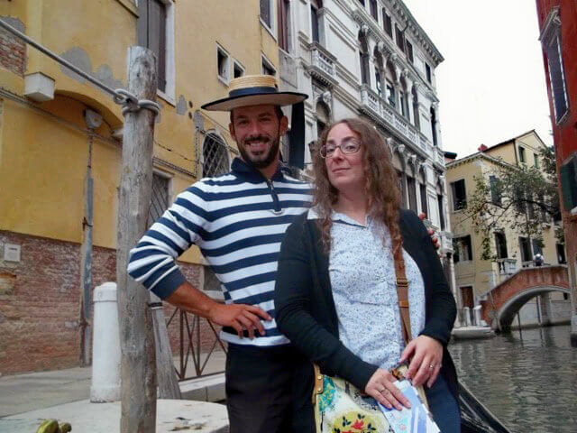 Posing with a gondolier in Venice