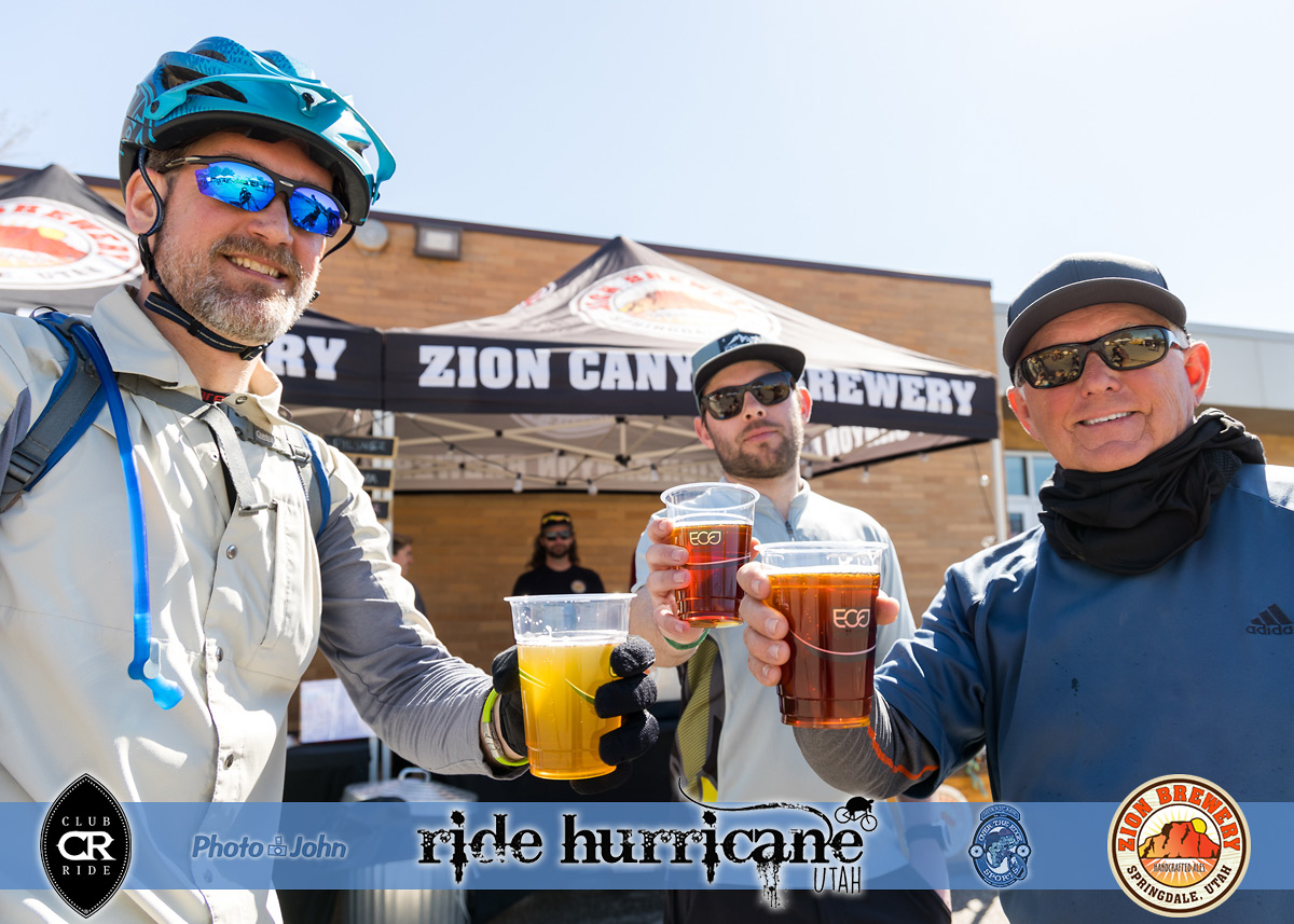 Three mountain bikers with beer at a bike festival