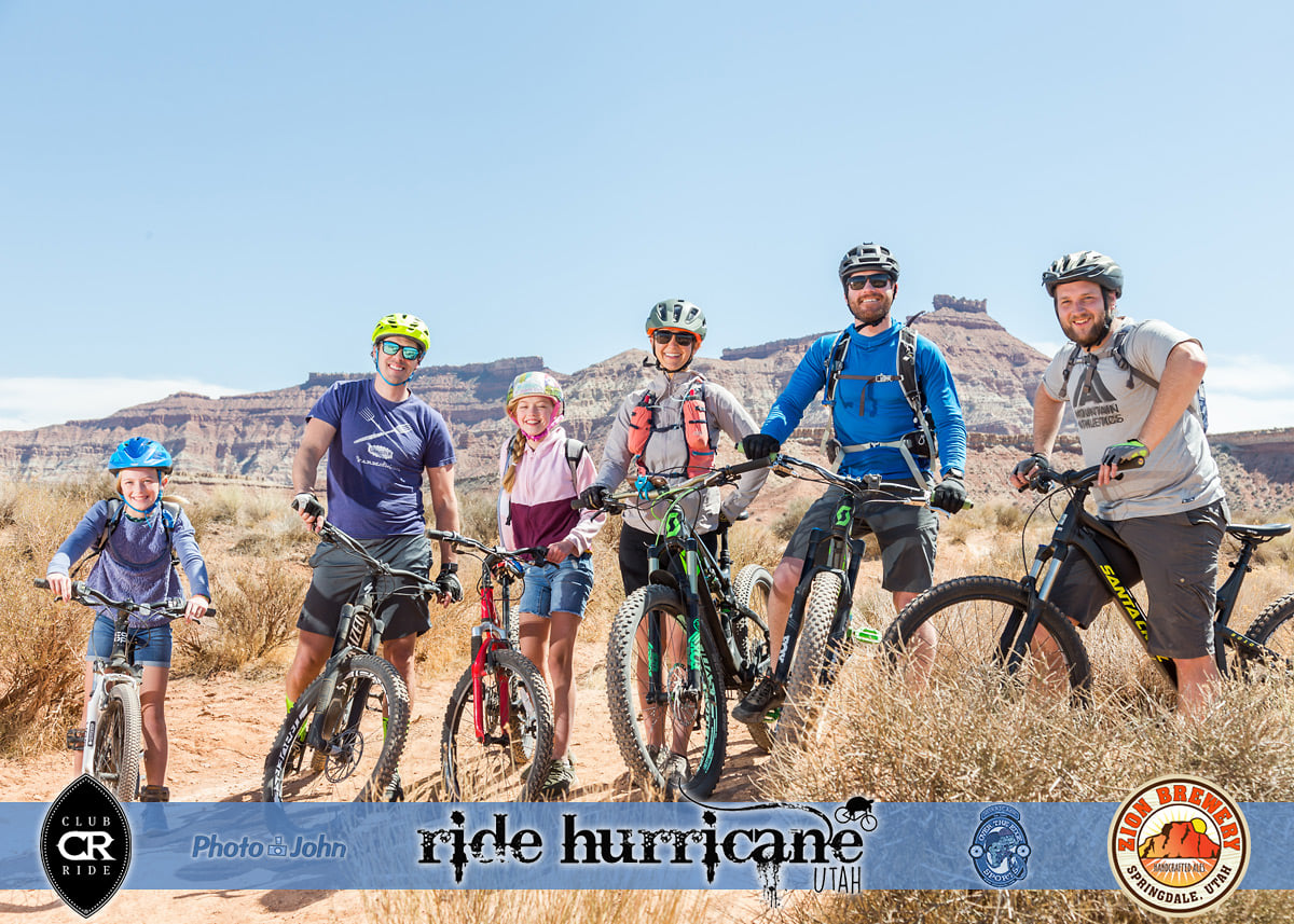 A family of mountain bikers posing on a Southern Utah trail.