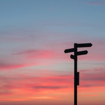 sunset (or sunrise) on silhouetted road signs