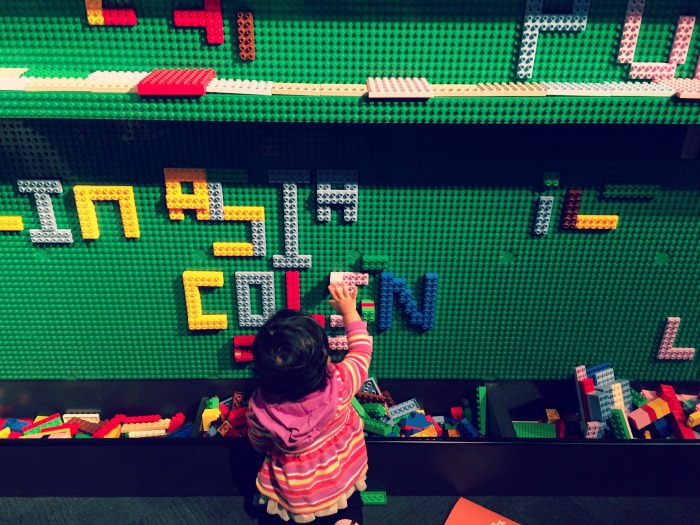 Kids can build on the walls with LEGOs at the Museum of Science and Industry's Brick by Brick exhibit.
