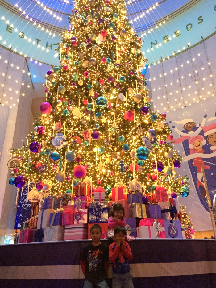 the tree in the rotunda is humongous im talking a 45 foot tall grand tree and its obviously the perfect opportunity for a holiday picture with the kids - Christmas Around The World Chicago
