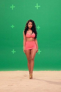 "Nicki Minaj shows off her curves while shooting in front of a green screen on May 8, 2014. She Instagrammed: ""@myxfusions commercial. #normakamali #gucci."""