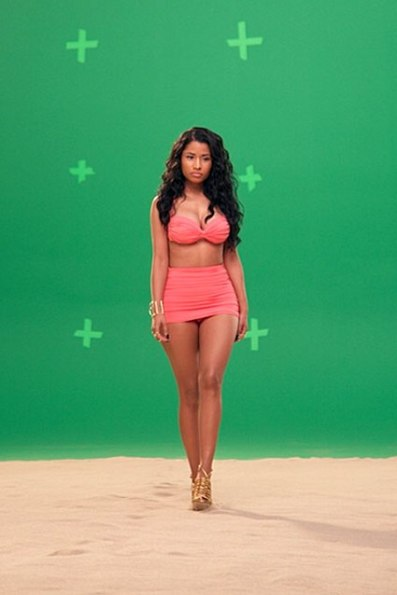 """Nicki Minaj shows off her curves while shooting in front of a green screen on May 8, 2014. She Instagrammed: """"@myxfusions commercial. #normakamali #gucci."""""""