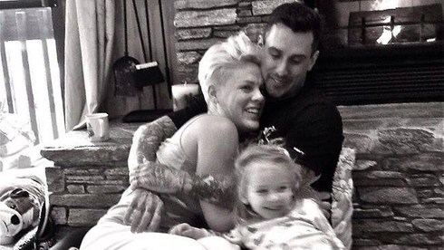 Pink checked in with this pic of she, baby Willow and hubby Corey Hart