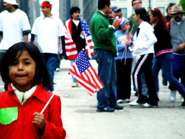 Hispanic American Child Holding Flag