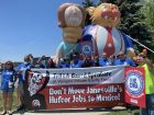 Demonstrators in Janesville, Wisconsin protest OpenGate's plan to move 166 Hufcor jobs to Mexico.
