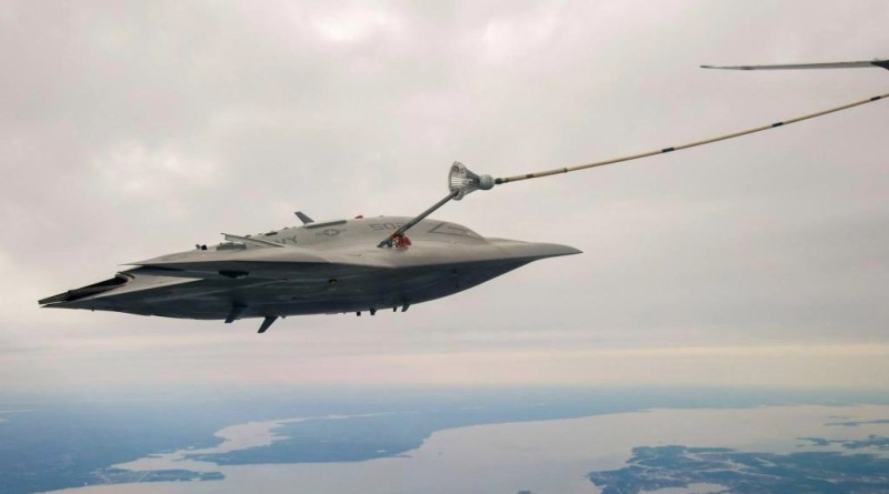 X-47B combat drone taking fuel from an Omega Aerial Refueler off the coast of Maryland.