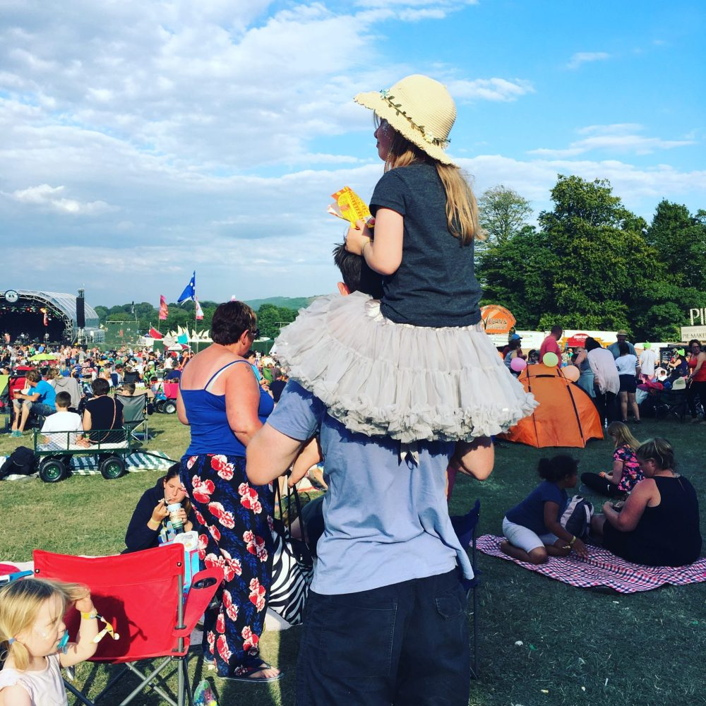 pack fancy dress, suncream, hats and wellingtons when visiting a festival with kids