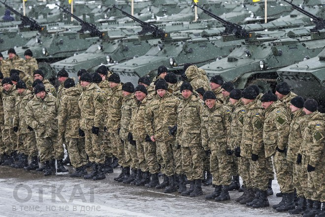 epa04547477 Ukrainian servicemen stand in front of their armored personal carriers (APC) at a military base near Zhytomir, about 140 kilometers west of the capital Kiev, Ukraine, 05 January 2015. Ukrainian President Petro Poroshenko handed over to Ukrainian army more than one hundred units of weapon, military equipment and aircrafts during his meeting with Ukrainian servicemen. Meanwhile Moscow and Kiev have both said 05 January that they do not expect much to come of talks to be held in Berlin later the same day about the ongoing civil conflict in eastern Ukraine. EPA/SERGEY DOLZHENKO